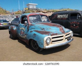 30th June 2018- A classic Studebaker pickup truck parked on the sandy beach at Pendine, Carmarthenshire, Wales, UK.