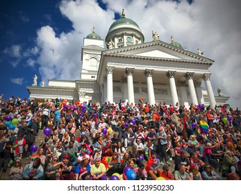 30th June 2018 helsinki Finland. Helsinki pride 2018. Peoples together celebrating for human rights. Crowd sitting front of Helsinki cathedral.