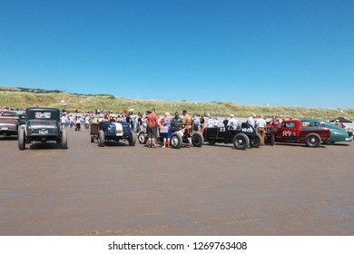 30th June 2018- A lineup of customised vintage cars at a hotrod event on the sandy beach at Pendine, Carmarthenshire, Wales, UK.