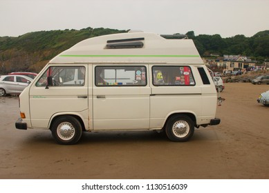 30th June 2018- A lovely Volkswagen campervan parked on the sandy beach at Pendine, Carmarthen, Carmarthenshire, Wales, UK.