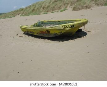 30th June 2019. Abandoned boat on Salcombe Sands, Devon.
