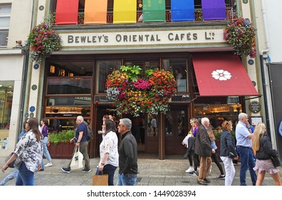 30th June 2019, Dublin, Ireland. The image is of one of Dublin's most popular cafes, Bewley's on Grafton Street, with a flower display hanging outside.