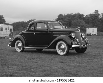 30th September 2018- A 1936 American Ford V8 coupé being driven at a  classic car show in Pembrey Country Park near Llanelli, Carmarthenshire, Wales, UK.