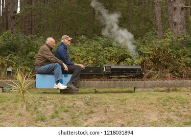 30th September 2018- A man driving a scale model of a steam engine on rhe miniature railway in Pembrey Country Park near Llanelli, Carmarthenshire, Wales, UK during a vintage vehicle show.