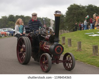 30th September 2018- A man & girl on a scaled down version of The Burrell Traction Engine at a vintage vehicle show in Pembrey Country Park near Llanelli, Carmarthenshire, Wales, UK.