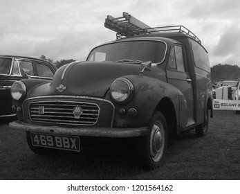 30th September 2018- An old Morris Minor 1000 van, with ladders on the roof rack, at a classic car show in Pembrey Country Park near Llanelli, Carmarthenshire, Wales, UK.