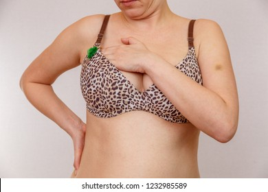 aab51eb2fce A 30-year-old overweight Caucasian woman examines and examines her breasts  in a