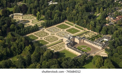 31 July 2017, Apeldoorn, Netherlands. Aerial shot of Royal Palace Het Loo. The castle was built in the 17th century and King and Queen used to live here. Now it's a museum baroque ornamental gardens.