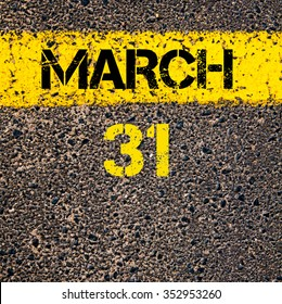 31 March calendar day written over road marking yellow paint line