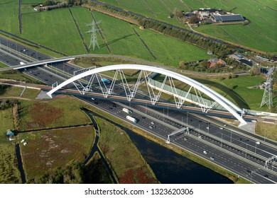 31 October 2018, Muiderberg, Holland. Aerial view of railway bridge ZANDHAZENBRUG crossing freeway A1. This is at the intersection with highway A6.