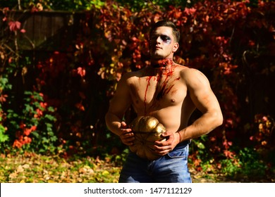 31 october. Make up and scary concept for man. Death - young man Halloween portrait. Close-up portrait of a horrible scary zombie man. Celebration party. Strong man body. Hot guy. Fitnes