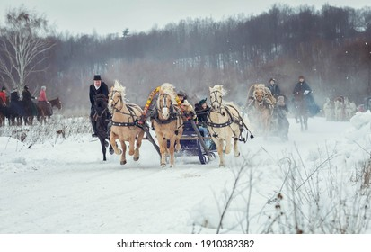 31.01.2021 , Russia, Moscow . Three horses harnessed abreast, carriage-and-three compete in speed with a rider