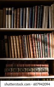 31/10/2016, Leeds, United Kigndom: The light of the window on some bookshelves full of books at Leeds castle