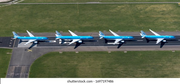 31-3-2020, Haarlemmermeer, Holland. Aerial view of Schiphol Amsterdam International Airport. Airliners from KLM Royal Dutch Airlines Air France are parked at runway Aalsmeerbaan, due to Corona crisis
