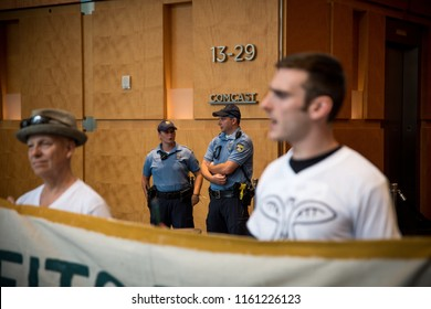 31st July, 2018, Philadelphia, USA, Protesters arrested following an occupation of the Comcast building in protest of Comcast's contracts with Immigration and Customs Enforcement (ICE)
