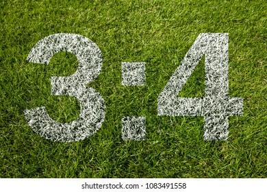 3:4 on soccer meadow
