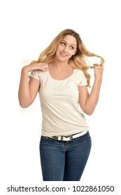 3/4 portrait of blonde girl wearing white shirt,  happy expression. isolated on white background.
