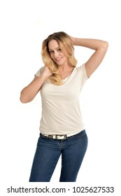 3/4 portrait of blonde girl wearing white shirt,  posing with hands touching body. isolated on white background.