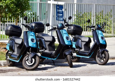 3/5/2020 Miami FL Multiple Revel electric mopeds on a street in a trendy residential neighborhood.