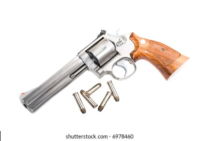 A 357 magnum revolver with bullets isolated on white