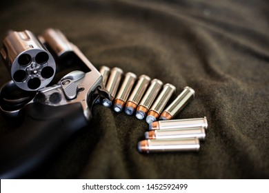 357 magnum revolver classic gun with bullet on cloth background
