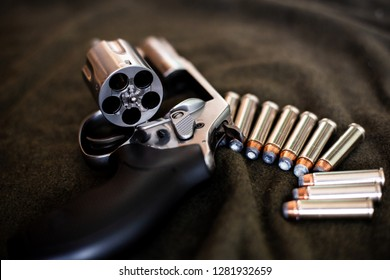 .357 magnum revolver stainless steel hand gun on cloth background