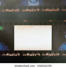 35mm film contact sheet with empty white frame or window for your content, empty film border on real photo silk paper with scratches