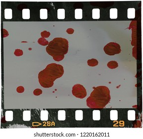 35mm film frame with paint on it that looks like bloodstains, this picture could work as an evidence for your project or film