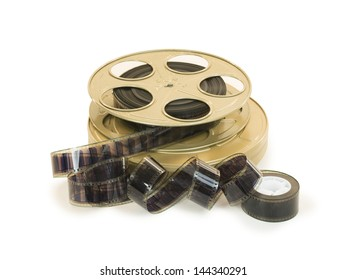 A 35mm film in a metallic golden reel and its can, isolated over white background, with clipping paths