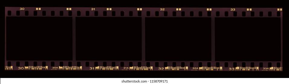 35mm old negative film slide or strip, empty for vintage retro camera pictures on a black background