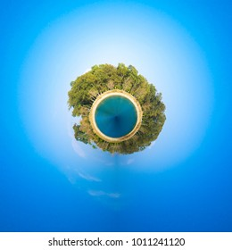 360 circle square spherical Planet panorama of a clean blue sky, trees and sea.