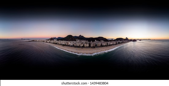 360 degree aerial panorama of Copacabana beach in Rio de Janeiro just before sunrise with the sun rising behind the sugarloaf mountain ready for use in 3D environment mapping and 360VR.
