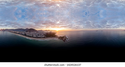 360 degree aerial panorama of Rio de Janeiro seen from just off the coast of the Arpoador rock with the wider cityscape in the background at sunrise ready for use in 3D environment mapping and 360VR.