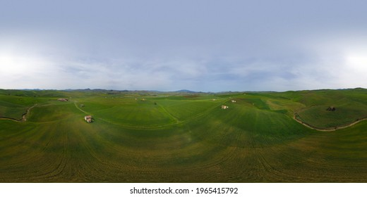360 degree aerial photo of wheat fields with a view of Mount Etna in Sicily. Green wheat. Typical houses of Sicilian farmers. Sicilian wheat.