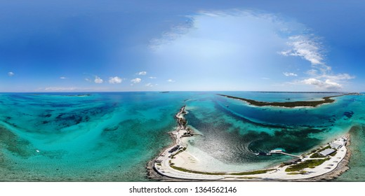 360 Degree aerial view photo of the beautiful Pearl Island in the Bahamas near Nassau, showing the beach and lighthouse of the island.