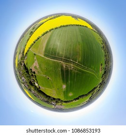 360 degree full circle (little planet) panoramic aerial view: a landscape in yellow, green and blue - the  agrarian landscape of rural Brandenburg near Berlin seen from an altitude of over 100 meters.