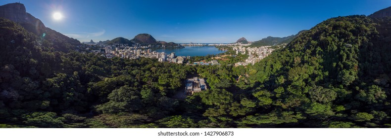 360 degree full panoramic aerial view of Rio de Janeiro with the Corcovado mountain, the city lake, and south side neighbourhoods with the Two Brothers peaks and Sugarloaf mountain in the background