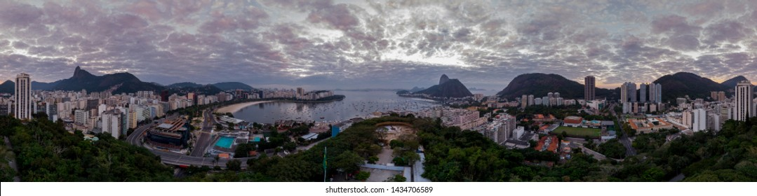 360 degree full panoramic view of Rio de Janeiro with Sugarloaf mountain and the wider cityscape of Guanabara bay and construction site of the new Holocaust museum in the foreground at sunrise