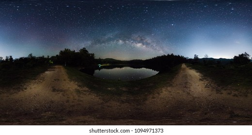 360 degree panorama of dark sky, star and milky way band across sky over reservoir.