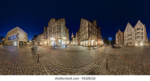 360 degree panoramic composition of old cobblestone section of Hanover, Germany, at twilight.