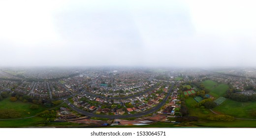 360 Degree panoramic sphere aerial photo of typical British park and town, taken in the Crossgates area of Leeds in West Yorkshire showing the park and housing estates with rows of houses.