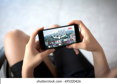 360 degree social media online video live streaming concept.Female hands holding mobile phone