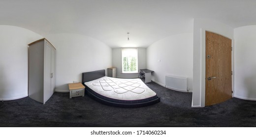 360 Degree spherical panorama sphere photo of a typical British Bedroom, the bedroom is brand new and has a brand new leather bed and chest of drawers with a white radiator and dark carpet white walls