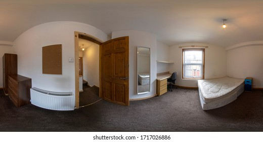 360 Degree spherical panorama sphere photo of a typical British Bedroom showing a bed, desk, drawers and white  radiator with a brown carpet