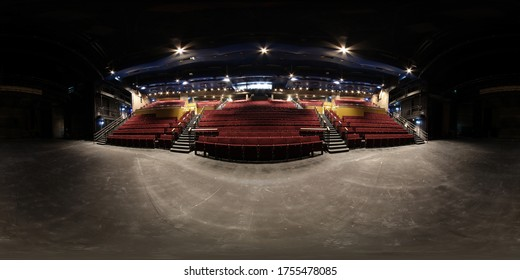 360 Degree spherical panorama sphere photo of the inside of an empty typical British theatre showing rows of empty  red chairs and a large open stage area below. - Shutterstock ID 1755478085