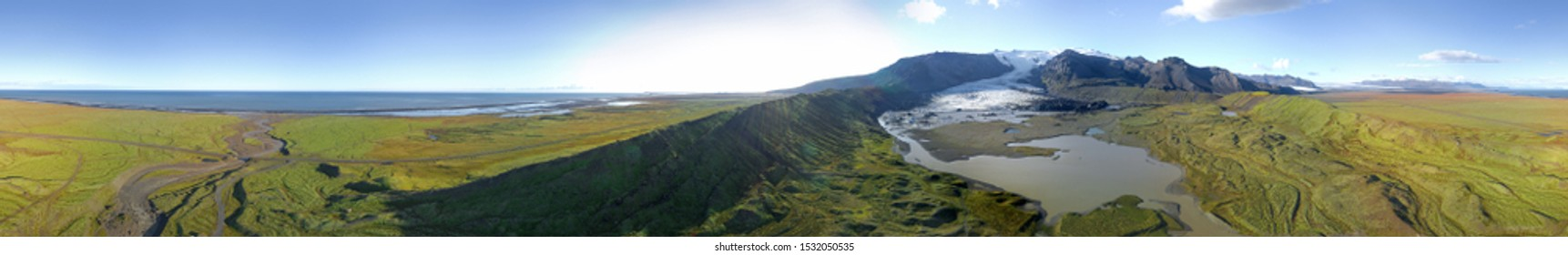 360 degrees Icelandic aerial landscape. 360 panorama of the Fjallsarlon glacier and the lagoon on a sunny day.