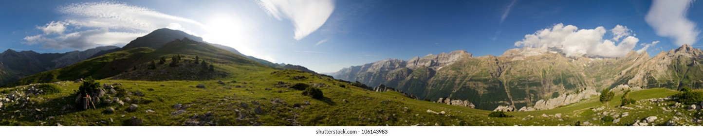 360 degrees panorama of a Pyrenees landscape with a beautiful blue sky in the background.