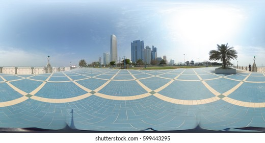 360 degrees spherical panorama of the abu dhabi corniche with view of the skyline an blue water an palm trees (UAE)