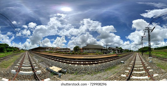 360 degrees spherical panorama of railway station with blue sky