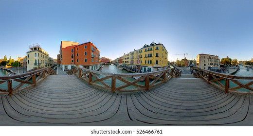 A 360 degrees (spherical) view of a bridge with a canal in Venice. 